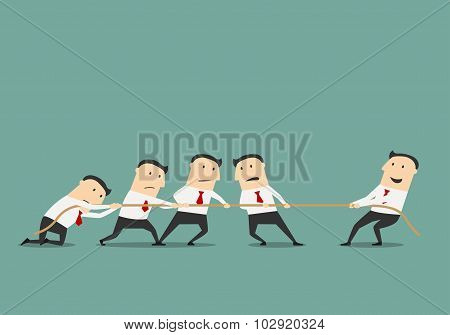 Businessman tug of war with group
