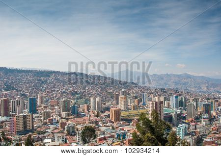 Cityscape Of La Paz, Bolivia With Illimani Mountain Rising In Th