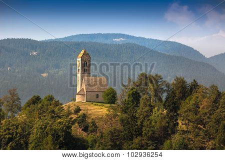 Hilltop church in South Tyrol in Italy poster