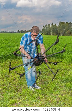 Technician calibrating multicopter' compass pilot copter aviation