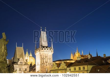 Night View On Prague Lesser Town With Cathedral, Bridge Tower And Castle