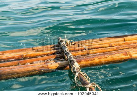 Broken bamboo raft float on the water