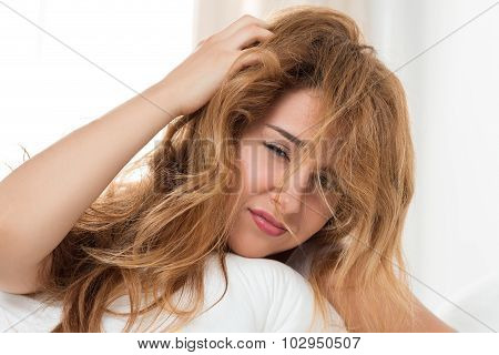 Young Tousled Woman Waking Up