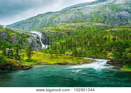 Giant Waterfall in the Valley of waterfalls in Norway.