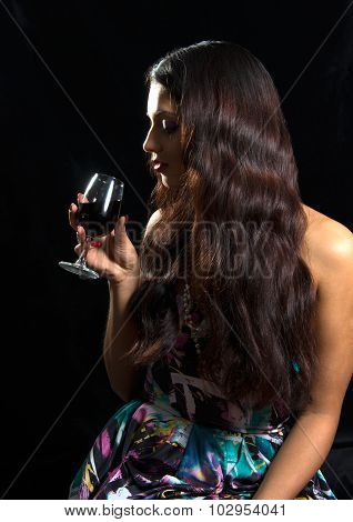 Brunette Drinking Red Wine