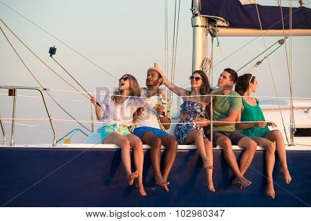 Merry company celebrates birthday on a yacht.