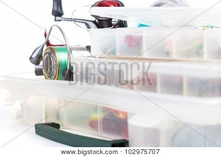 Fishing Tackles And Lure In Storage Boxes