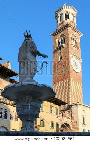 VERONA, ITALY - SEPTEMBER 2014 : Statue of Madonna fountain on Piazza delle Erbe in the old town of Verona, Italy. on September 13, 2014. City of Verona is one of the UNESCO World Heritage sites.