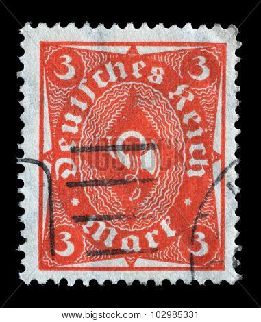 GERMANY - CIRCA 1921: A stamp printed in Germany shows a posthorn, circa 1921.