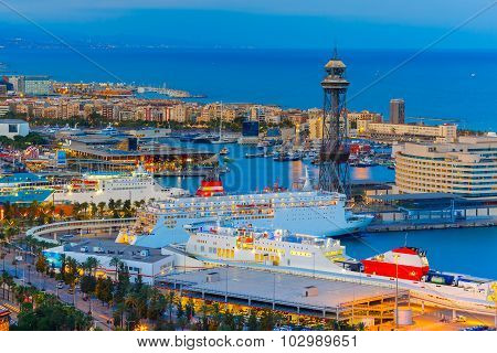 Aerial view over Port Vell marina and Rambla de Mar at night in Barcelona, Catalonia, Spain poster