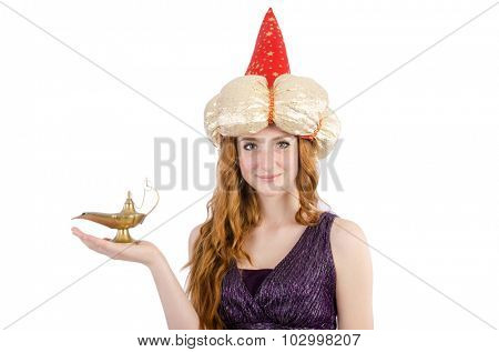 Pretty girl holding magic lamp isolated on white