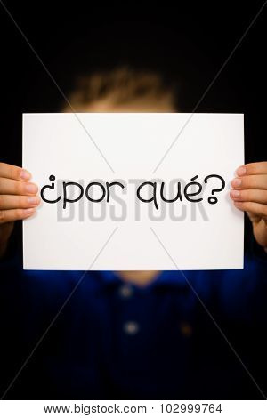 Child Holding Sign With Spanish Words Por Que - Why