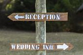 Direction signs for wedding inquiries reception outside rural countryside poster