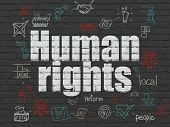 Political concept: Painted white text Human Rights on Black Brick wall background with Scheme Of Hand Drawn Politics Icons poster