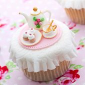 Cupcake decorated with mini sugarpaste tea party poster
