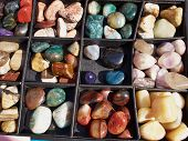 Selection of of semiprecious gemstones for sale in a flea market poster