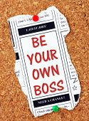 Be Your Own Boss in red text on a clipping from the classified advertising section of a newspaper, pinned to a cork notice board as a reminder to start your own business poster