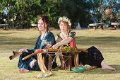 Pair of beautiful pagan women at outdoor altar poster