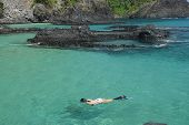 Diving in a crystalline sea beach in Fernando de Noronha, Brazil poster