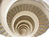 A scene from the top of a spiral staircase. poster