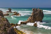 Beautiful coastline with rock formations at the coast at Kenton on Sea in South Africa poster