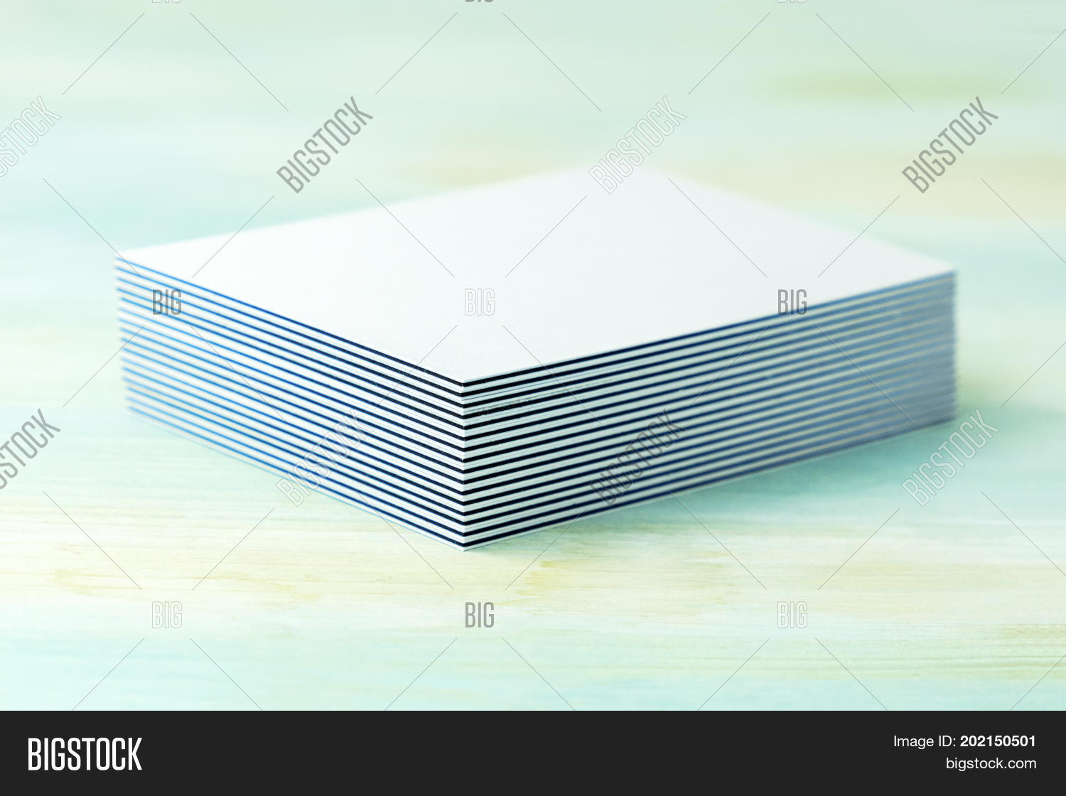 Stack blank layered business cards image photo bigstock a stack of blank layered business cards with painted edges on a teal background colourmoves