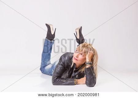 Mature Woman 40S Lying On Floor, Looking Sideways.