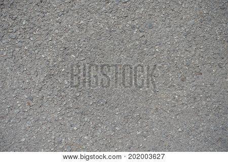 Close Up Of Grainy Surface Of Dusty Asphalt