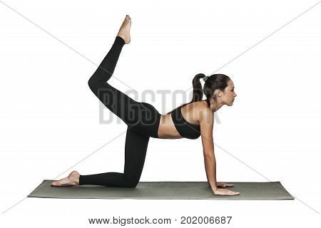 Young attractive brunette woman with fit body working out in yoga class. Healthy lifestyle concept. Isolated on white.