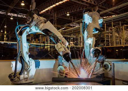 Industrial robot are test run new program in automotive factory