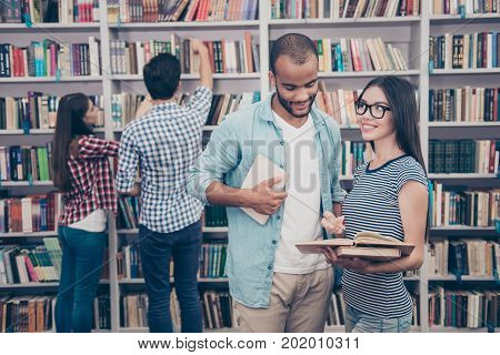 Couples Of International Students Are Studying After Lectures In The Library, Smiling, Chatting, Enj