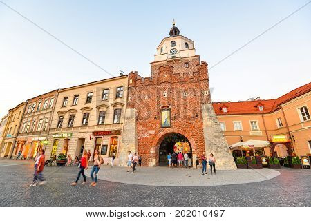 Lublin, Poland - August 10, 2017: Old Cracow gate in Lublin, Poland. Lublin old town city center, Poland. Beautiful street and old colorful buildings in the old town of Lublin.