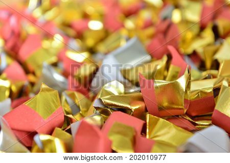joss paper gold and silver paper for worship with Joss Paper Chinese Tradition. Gold Paper folded for passed away ancestor's spirits for chinese ceremony.