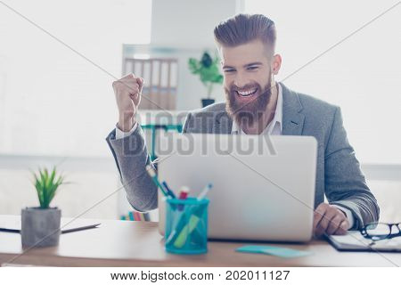 Excited Young Freelancer Is Working With Computer And Celebrating His Triumph, Wearing Formal Suit,