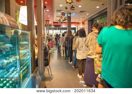HONG KONG - OCTOBER 25, 2015: people queue at McDonald's restaurant. McDonald's primarily sells hamburgers, cheeseburgers, chicken, french fries, breakfast items, soft drinks, milkshakes, and desserts