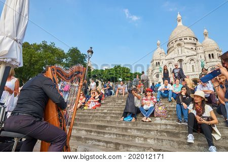 PARIS, FRANCE - CIRCA SEPTEMBER, 2014: people listen music at Montmartre.