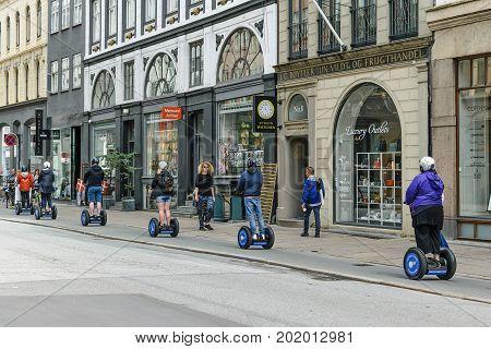 Copenhagen Denmark - July 24 2017: Tourist group having guided Segway city tour in Copenhagen Denmark.