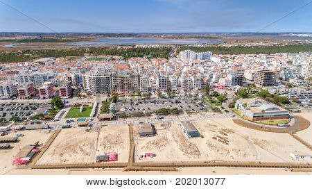 Aerial. Beaches and houses tourist city Monte Gordo view from the sky
