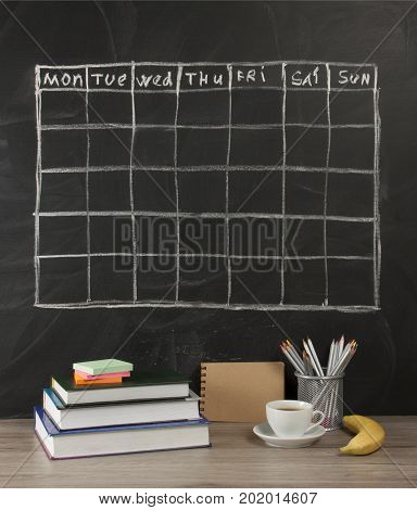 Grid timetable schedule on black chalkboard background