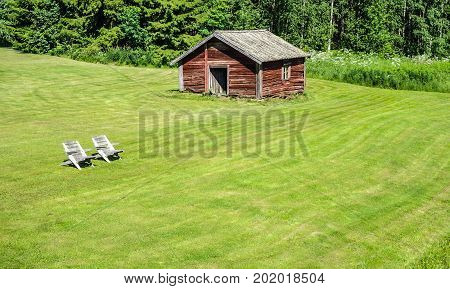 Wooden shed and chairs in Finland for relaxing time
