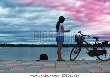 A Traveler Woman  Looking A Map At Rever Side