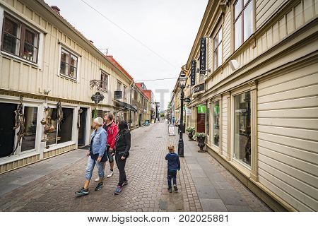 Tourists Looking At Windows In A Shopping Street