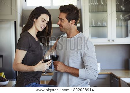 Young Romantic couple with wine in kitchen
