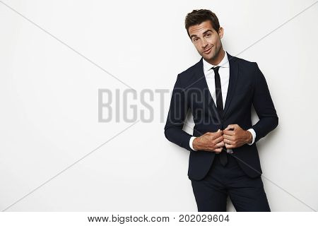 Handsome dude in business suit in white studio