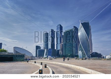 View on Moscow City business center skyscrapers office buildings, luxury apartments. People on sightseeing viewing point. Moscow city skyscrapers panorama. Modern european russian architecture