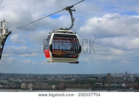 The Emirates Cable Car which spands the River Thames. It is a popular way of crossing the Thames it is managed by TfL and was opened to the public 2012. There is a car available every 15 seconds. Greenwich London England 2015