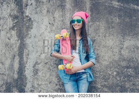 Lady With Long Board. More Colors To Your Life! Cute Charming Model In Hat And Eyewear In Jeans Wear