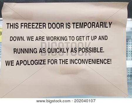 a this freezer door is temporarily down sign