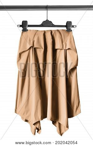 Beige draped casual skirt on clothes rack isolated over white