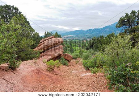 on the trail at garden of the gods national natural landmark and mountain landscape in colorado springs colorado
